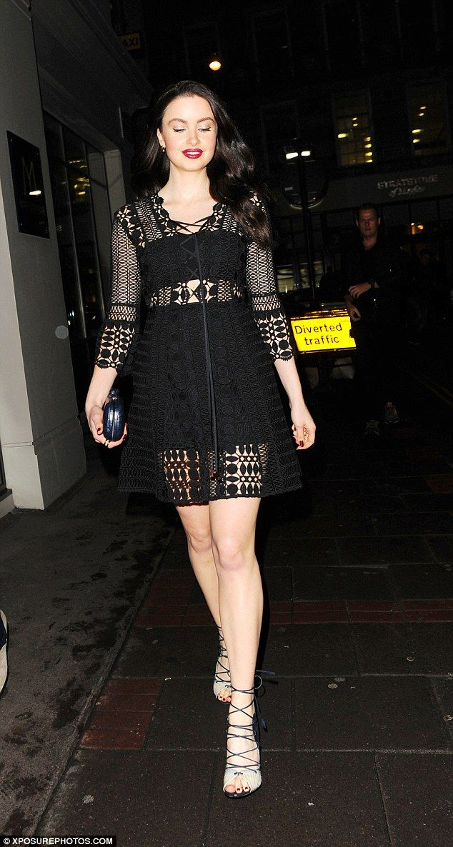 Little black dress: Emma Miller looked gorgeous in a sheer lace dress and lace-up heels by...