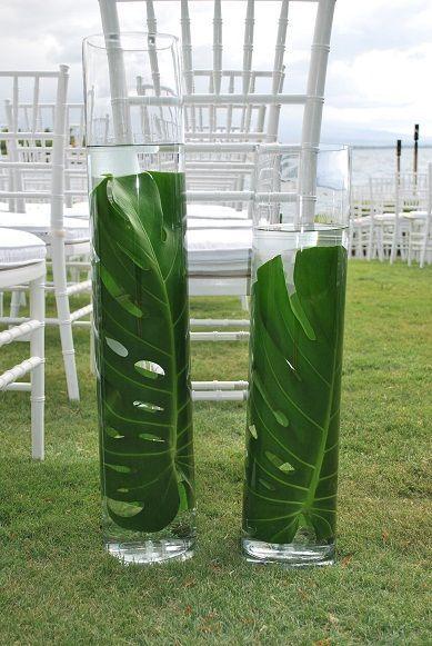 submerged monstera leaf wedding decor / http://www.himisspuff.com/green-tropical-leaves-wedding-ideas/6/