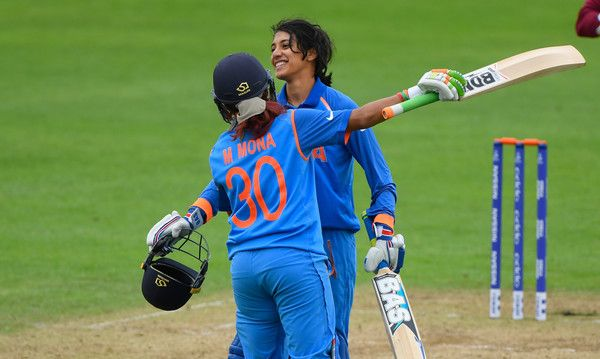 Smriti Mandhana Photos Photos - India batsman Smriti Mandhana celebrates her century with Mona Meshram during the ICC Women's World Cup 2017 match between West Indies and India at The County Ground on June 29, 2017 in Taunton, England. - West Indies v India - ICC Women's World Cup 2017