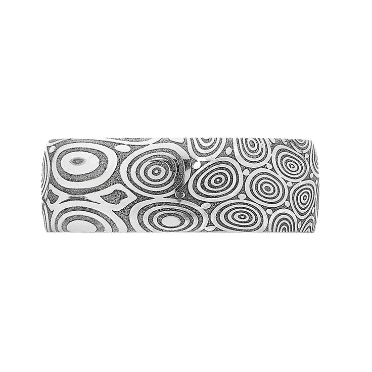 Damascus Steel Collection // Rohan Jewellery // A bubble Damascus steel ring with sterling silver sleeve.