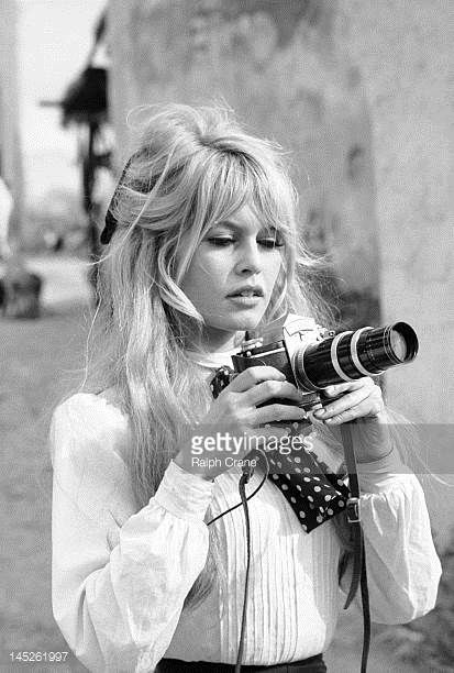 French actress Brigitte Bardot holds a camera during a break in the filming of the movie 'Viva Maria' Texcoco Mexico February 1965.Brigitte Bardot photo gallery. #brigettebardot #vintage #celebrities #actresses #1960s #1950s