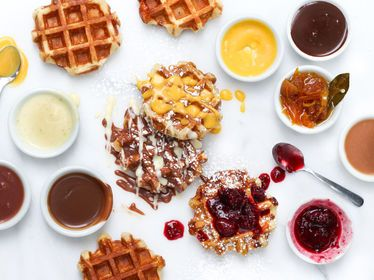 Cafe Medina Vancouver, Vancouver Coast and Mountains food plate table indoor dish meal breakfast waffle belgian waffle produce dessert snack food sauce dinner variety