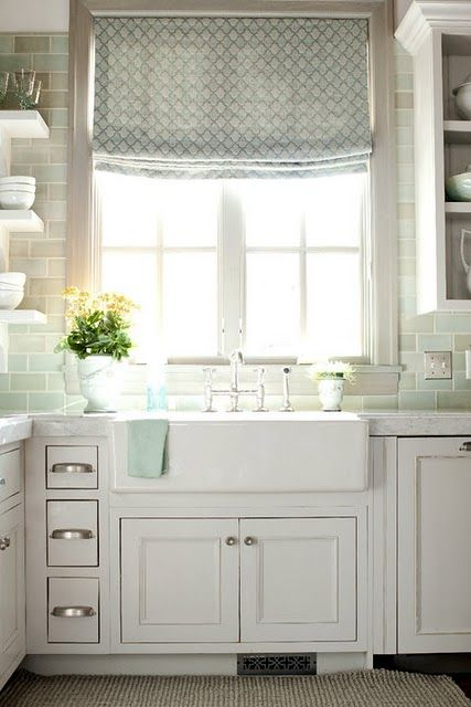 another winner!  so in-love w/this kitchen:  open shelves; tile; roman shade; windows; window trim (greige?) faucets; cabinets; small drawers; farmhouse sink; area rug -- almost makes me cry!