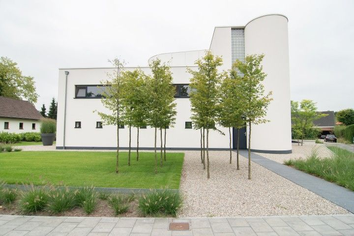 www.hendrikshoveniers.nl Strakke tuin - Grind - Bomen - Voortuin