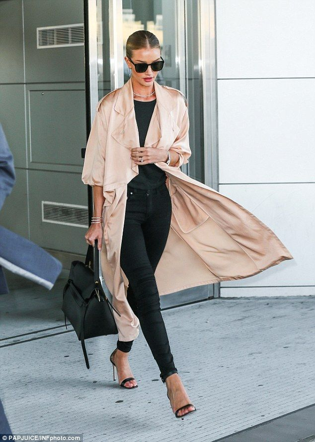 Jetsetter: Rosie Huntington-Whiteley looked extremely chic as she glided through LAX airport before arriving in JFK on Wednesday