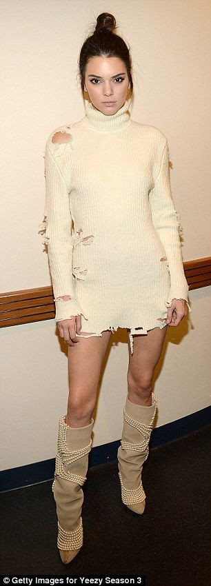 Sweater weather:The ladies both wore a high necked ribbed white dress which featured rips across it