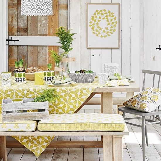 Let yellow bring a touch of spring to a kitchen dining area. Mix and match patterns on bench and seat cushions, table linen and artwork, but keep them all co-ordinating by matching the tone of yellow