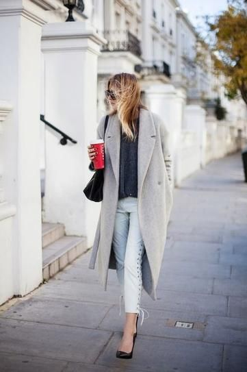 Winter Outfit Inspiration: Long gray coat over a sweater, lace-up skinny jeans, and heels.: