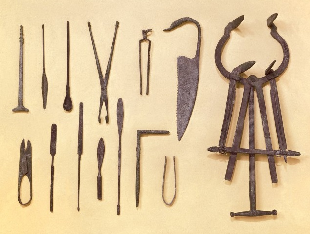 Greco-Roman surgical instruments; the large obstetric dilator on right is a replica