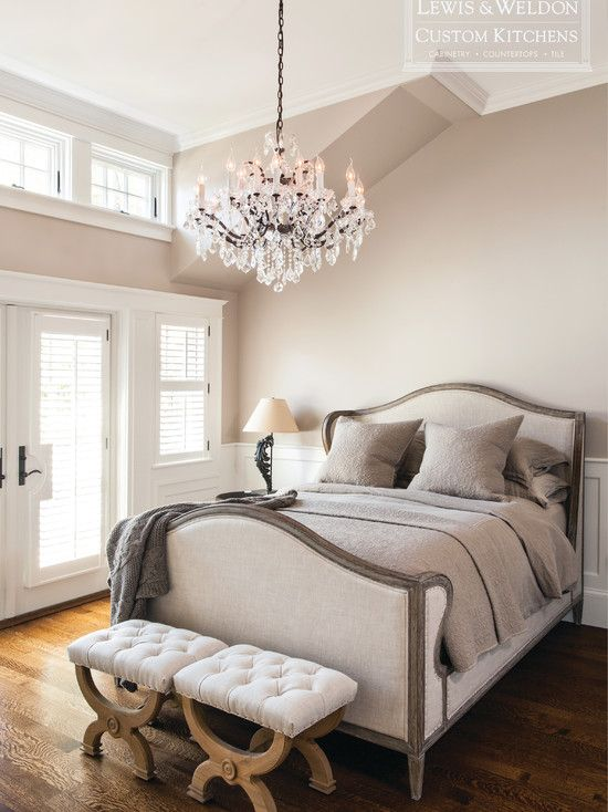 Lewis and Weldon: French style bedroom with upholstered linen bed and ornate crystal chandelier. The ...