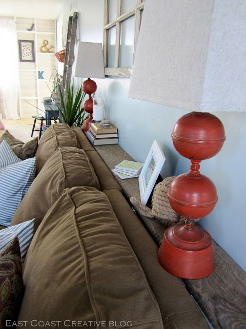 In love with this idea of a shelf behind the couch! So very very clever