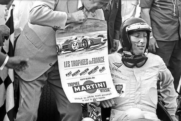 Poster of the Throphees de france shown to Jochen Rindt - Brabham BT23 Cosworth FVA - Roy Winkelmann Racing - XV Grand Prix de Rouen - 1967 Trophées de France, Round 3