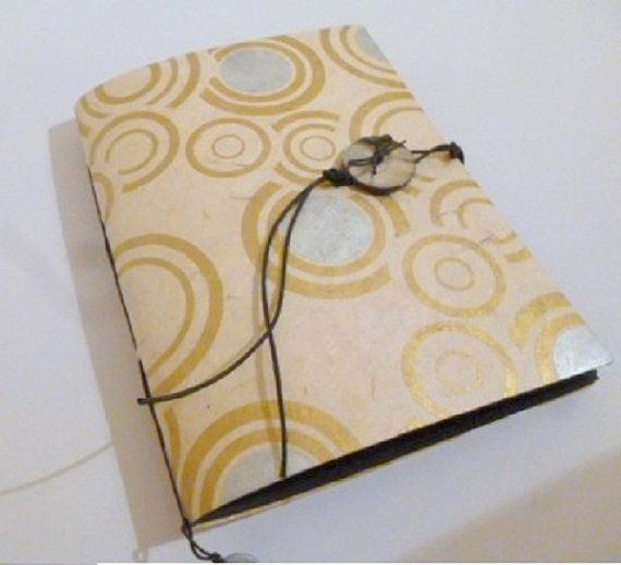 Quaderno portafoto con pagine interne nere di TRACCEBOTTEGAARTIGIA