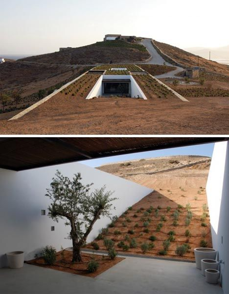 underground green roof home - This rectangular structure designed by Deca is very eco-friendly, utilizing natural light and heat, and cooling cross-winds. Built between the slopes of two adjacent hillsides, the house has a simple box-like plan that blends into the surrounding desert, while still incorporating traditional Greek design elements. The house is visible only in the center, and even then could pass as a half-buried ruin more than a modern home.