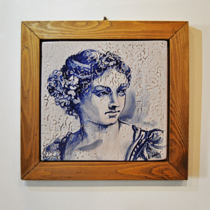 Ceramic tile, hand-painted with cobalt, with wooden frame. Cracking effect. Misures: 26,5 x 26,5 cm Subject: female face