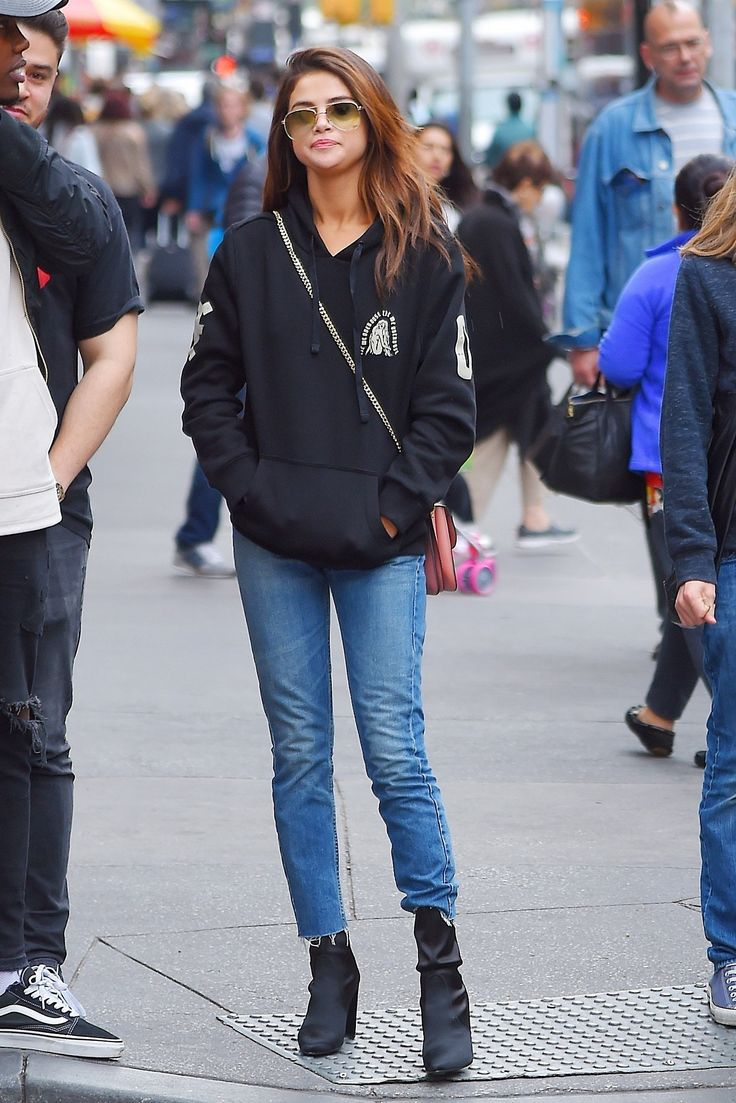Selena Gomez looking super casual in a hoodie and jeans.