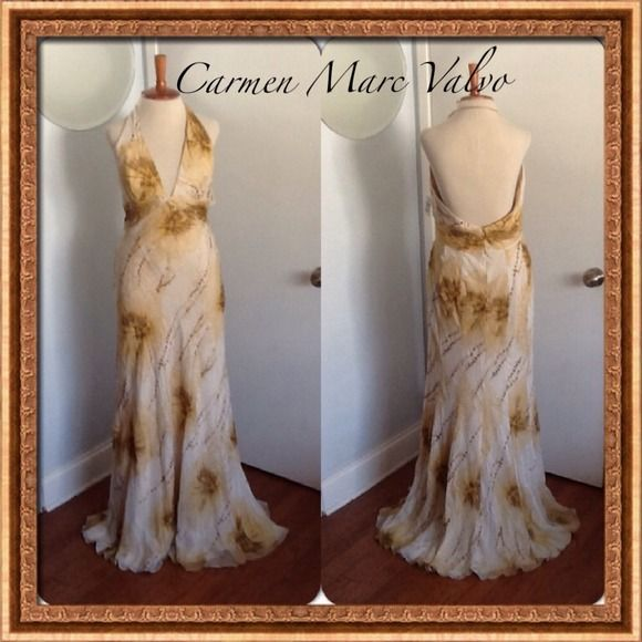 GORGEOUS Cream Beaded Gown by Carmen Marc Valvo Stunning cream silk with delicate gold beading halter gown by Carmen Marc Valvo Signature. Gentle flowing silhouette. All this dress needs is a gentle steaming and it's ready to go. Brand new with tags. Orignal price $940 purchased at Neiman's Last Call for $326. Ladies size 12. Carmen Marc Valvo Dresses