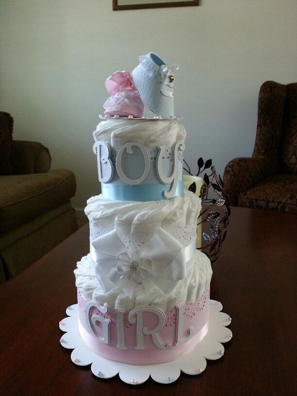 Three Tier Gender Reveal Diaper Cake / Gender Neutral Diaper Cake/ Pink And Blue Diaper Cake / Twin Diaper Cake by TheCarriageShoppe on Etsy https://www.etsy.com/listing/204119957/three-tier-gender-reveal-diaper-cake