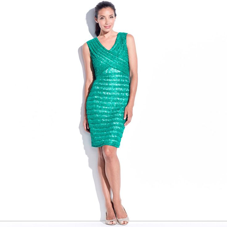 Roonah Pencil Dress - Oasis. This sleeveless tonal pencil dress has a soft cross over 'V' neck design and pleating panels across the body. It features sequined lace for textural interest.