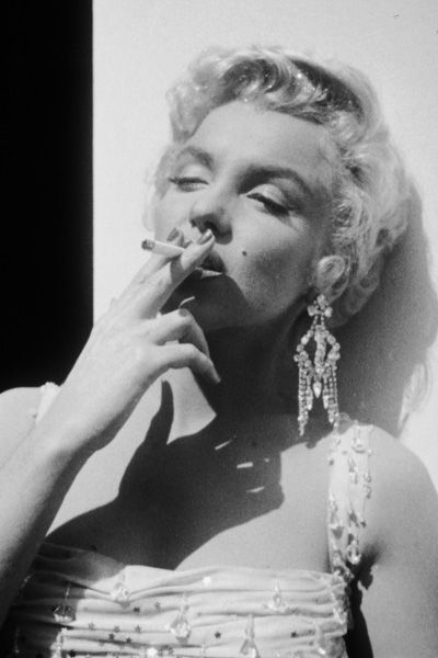 1954 While a cigarette can be spotted in many of the actress's photos, she is rarely seen actually smoking in pictures.