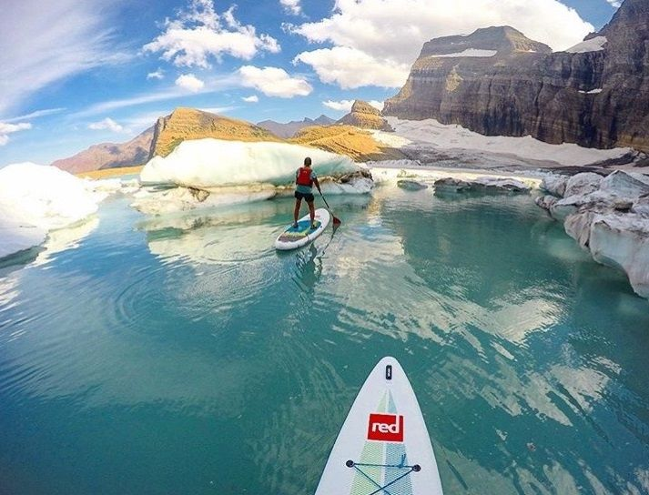 Experience the beauty of winter first hand by paddling between snow covered mountains and melting icebergs #exploreyourworld