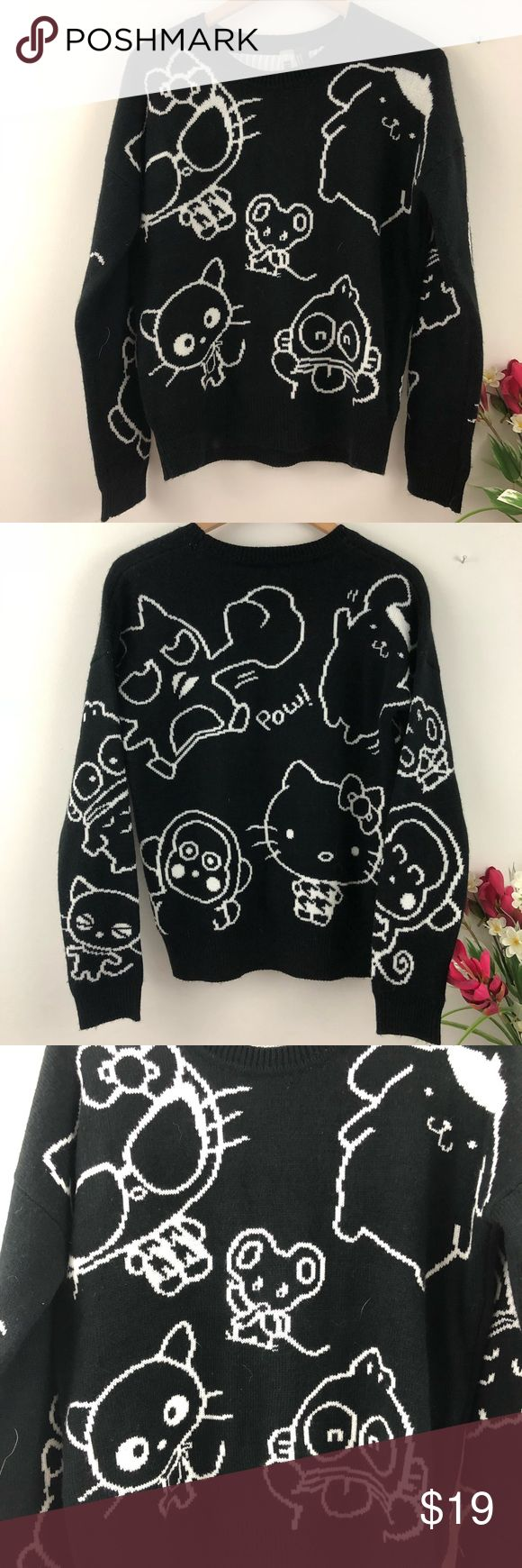 Forever 21 Sanrio Hello Kitty Thick Sweater Thick knit double layered sweater from Forever 21. Solid black background with Sanrio characters all over, including Hello Kitty. It's part of Forever 21's Collection Exclusive line. The black and white contrast nicely. It's in excellent, like new condition. The pit to pit and the length measurements are included in the last two pictures. (Location) {no trades - no modeling} Forever 21 Sweaters Crew & Scoop Necks