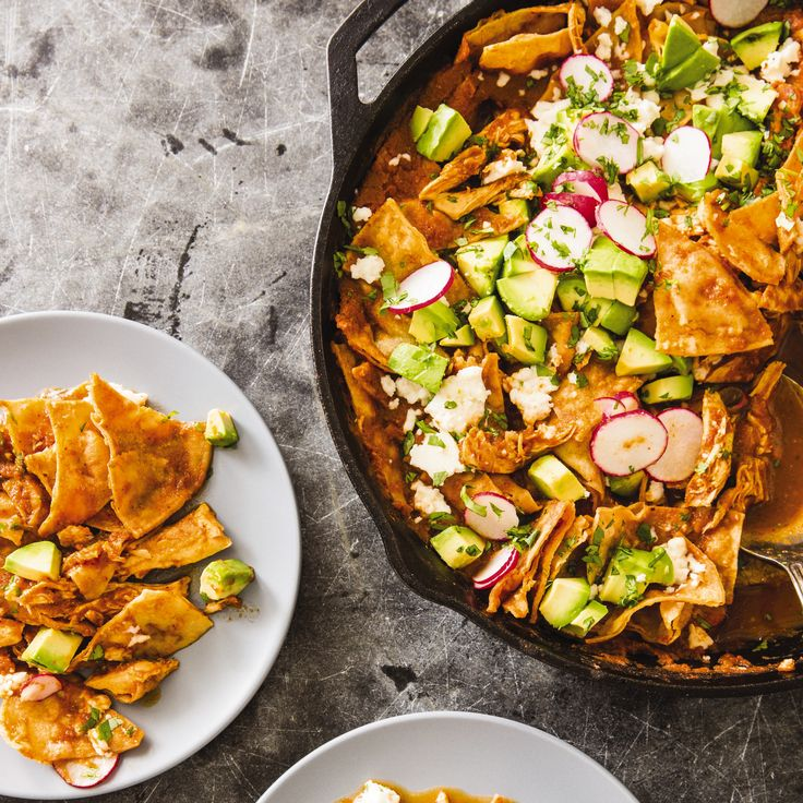 Chilaquiles is a Mexican comfort food favorite made from fried tortilla wedges tossed in a deeply flavored chile sauce.