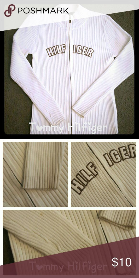 Tommy Hilfiger cream zip up ribbed sweater jacket PLEASE ASK QUESTIONS BEFORE OFFERS OR BUYING ALSO READ CLOSET DETAILS    Tommy Hilfiger zip up ribbed sweater jacket Sweater jacket is super stretchy and comfortable  There are some stains on the sleeves as shown in pics. Tommy Hilfiger Jackets & Coats