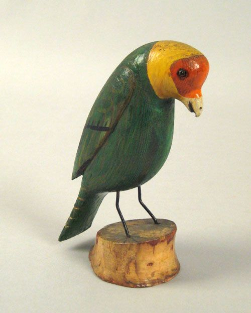 """Realized Price: $ 4914   Joseph Moyer(Berks County, Pennsylvania, 1883-1962), carved and painted parrot, signed on base """"Joseph Moyer 1946"""", 6"""" h."""