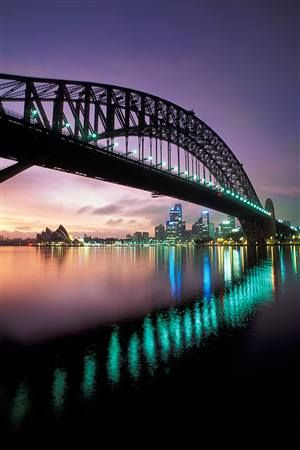 Sydney Harbor Bridge with the opera house in the background. Lovely!!