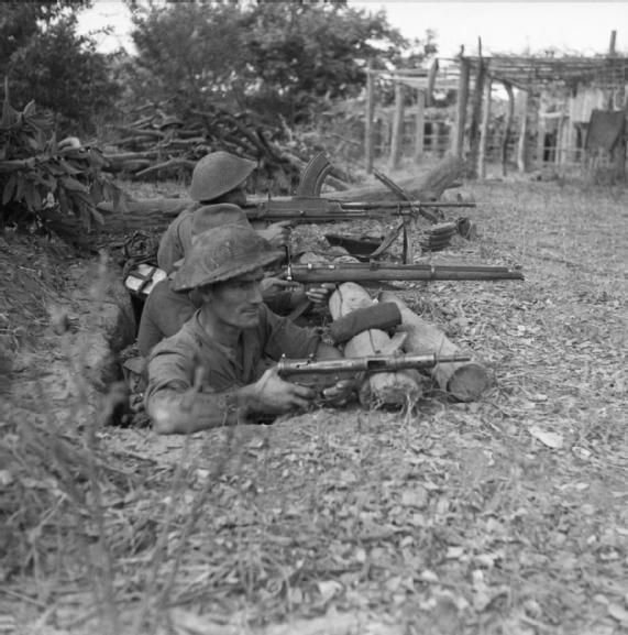THE BRITISH ARMY IN BURMA 1945 Men of the Royal Welsh Fusiliers, 36th Infantry Division, man a position by the River Mu's weir in anticipation of an enemy counter attack, January 1945.