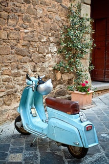 Groomsmen arrive at the wedding venue on classic Italian scooters complete with mod style helmets.