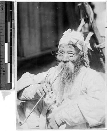Elderly Korean man with long beard smoking a pipe, Korea, ca. 1920-1940 :: International Mission Photography Archive, ca.1860-ca.1960