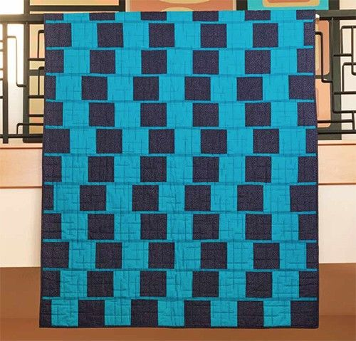 This quilt by Jean Nolte has so much movement it's almost hard to believe there are no diagonal seams! All the shapes are squares and rectangles and sew up easily into this 52 ½