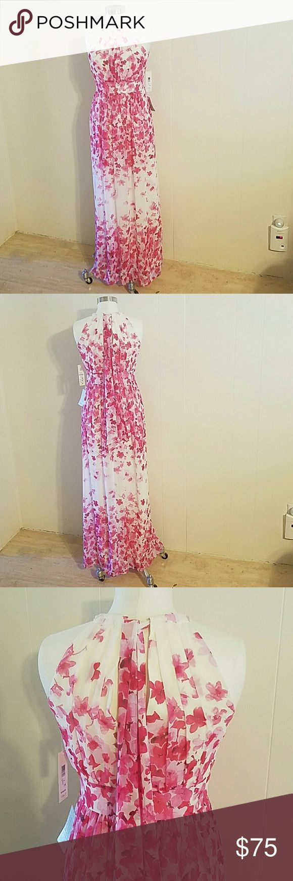 Floral Print Halter Maxi Dress Artsy pleats create a flattering shape down the halter style bodice, fitted waist  back zip closure, ties at nape, lined. Eliza J Dresses Prom