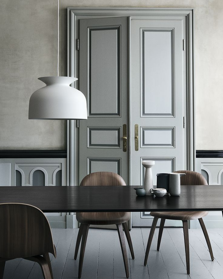 Soft greens, grey mouldings and walnut wood | barefootstyling.com