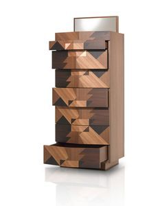 Porro stepped away from their typical minimalism and let the Italian designer do his thing with Maggio and Schermo. Using three different types of wood – elm, oak, and acacia – the fronts of the pieces become geometric compositions, elevating the sideboard to works of art and not just storage units. Each piece comes with a maple interior and elements made from pliable brass, bronze, and inox steel.
