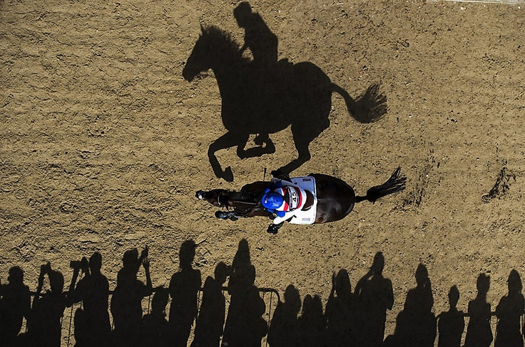 Thailand's Nina Lamsan Ligon riding Butts Leon rides past spectators as she competes in the Cross Country phase of the Eventing competition of the 2012 London Olympics at the Equestrian venue in Greenwich Park, London, July 30, 2012. (ADRIAN DENNIS/AFP/Getty Images)