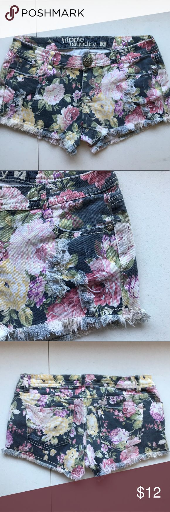 """Hippie Laundry distressed floral shorts Hippie Laundry brand floral shorts. Distressing on front of shorts. Front pockets. Plain rear pockets. 2"""" inseam. 7"""" rise. Approximately 15"""" across waistband when measured laid flat. 99% cotton/1% spandex. Please ask for additional information if needed before purchase. hippie laundry Shorts"""