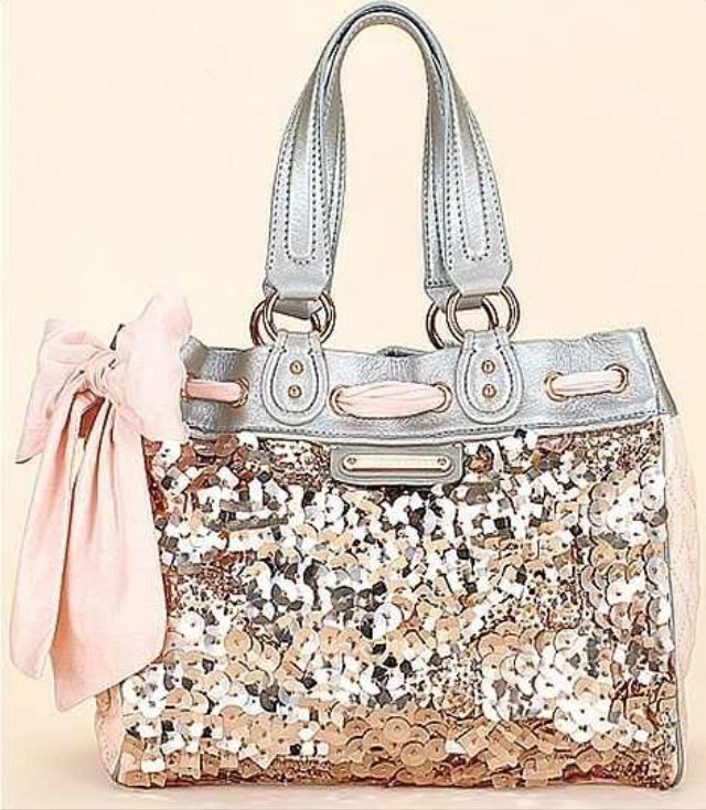 Silver glitter COACH purse. I don't care about name brands, id still love this purse even if it was from WalMart LOL  Need to find a knock-off somewhere!!!!