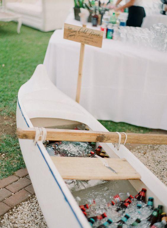 cool canoe reception bar idea / http://www.deerpearlflowers.com/rustic-canoe-wedding-ideas/