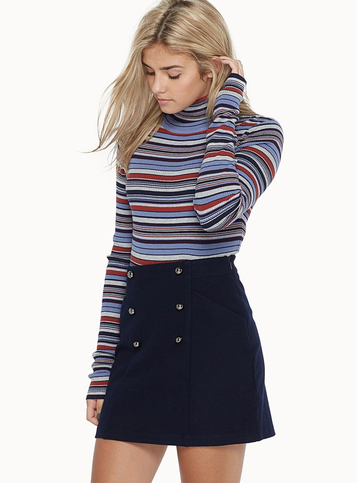Exclusively from Twik     A military-style skirt updated in a wool-like fabric with mirrored metal accent buttons   Rounded front pockets   Hidden side zip    The model is wearing size small