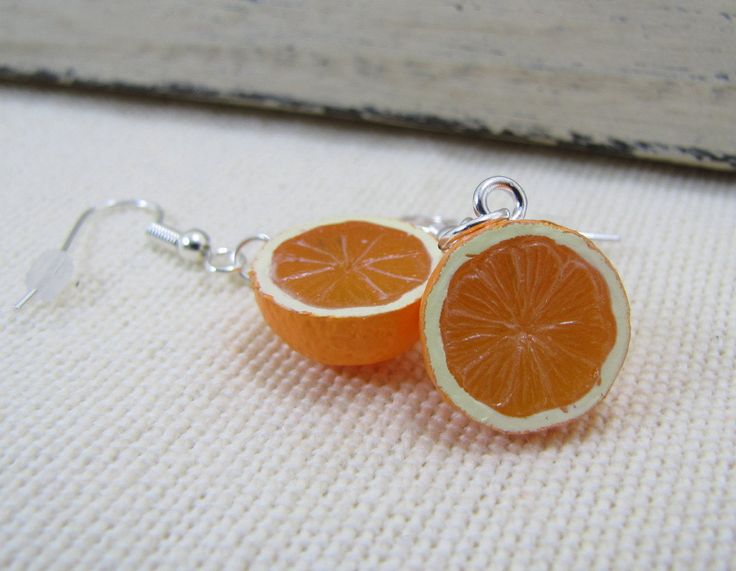 Orange Halve Dangle Earrings. $12.00, via Etsy.