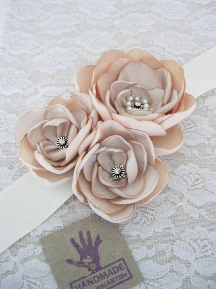 I know way too expensive but wouldn't this be a cute idea for all of you? We could make them?     Blush Champagne Cream Bridal Sash belt.    $47.95,