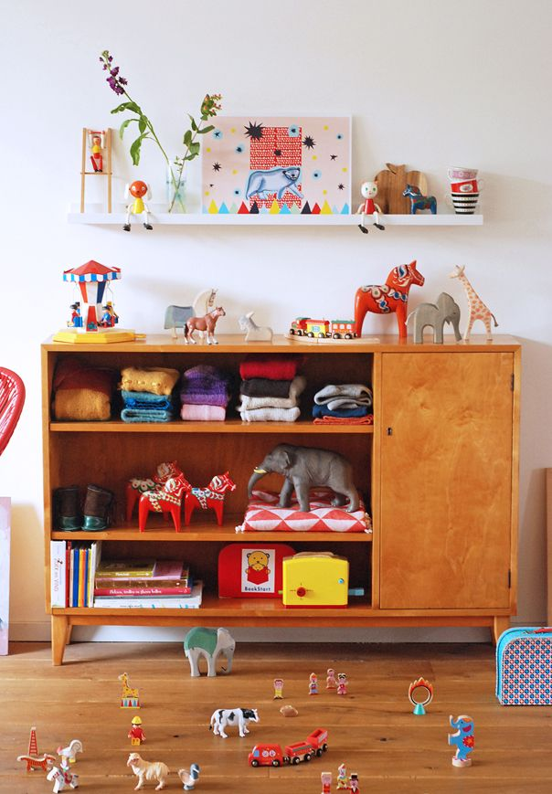 ikea ribba shelf popping up everywhere - great for displaying books and art and toys in kids rooms