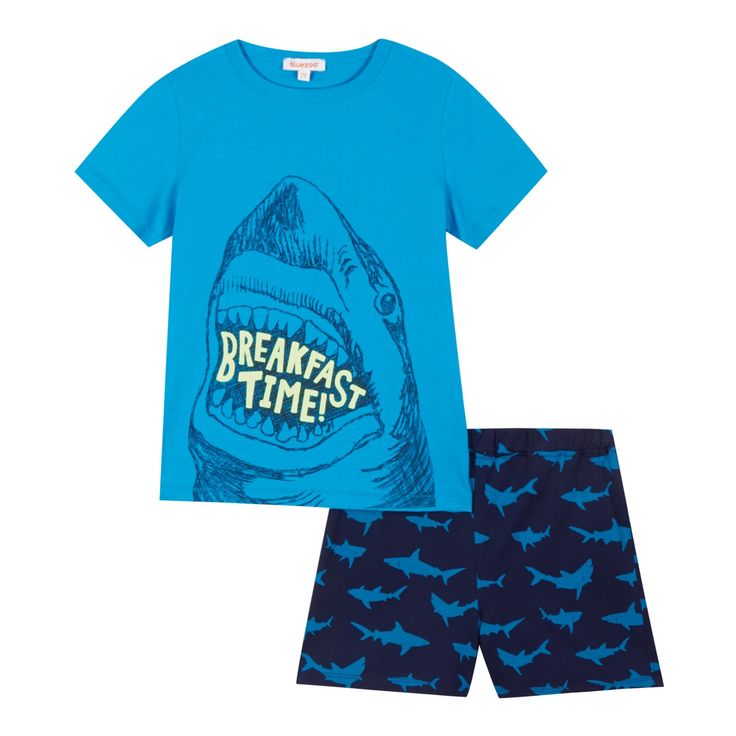 From bluezoo's fantastic range of children's clothing, this pyjama top and shorts set will inject a boy's casual wardrobe with colour. Made purely from cotton, the top features a classic crew neck and a ferocious 'Breakfast time' shark print on the front and all over shark print shorts.