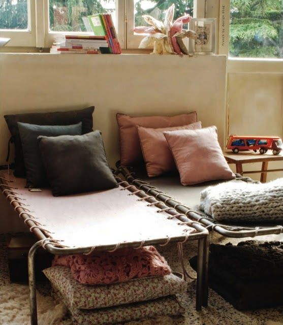 kids corner with vintage 1960s camping beds and washed out color pillows
