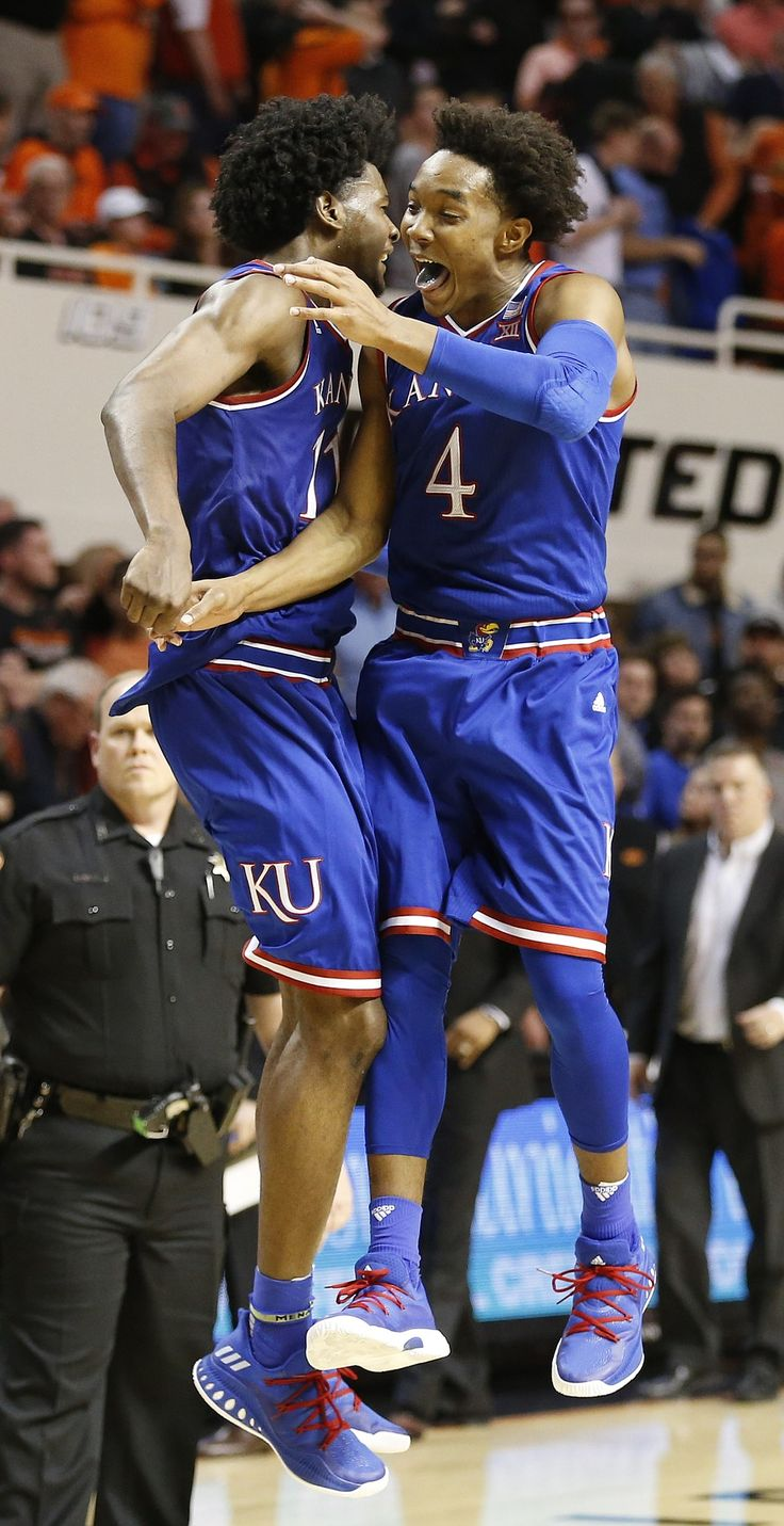 #1 Nationally Ranked Kansas Jayhawks Josh Jackson (#11) and Devonte' Graham (#4) celebrate the KU win over OSU in front of a sold out Away crowd 3/4/17 on the last game of the regular season