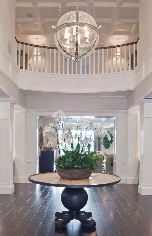 Worthing | Brooke Wagner Design.  Round table in entryway.