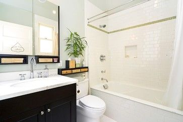 White Subway tile with marble countertop.  Floor is 12x12 white porcelain laid in a brick pattern